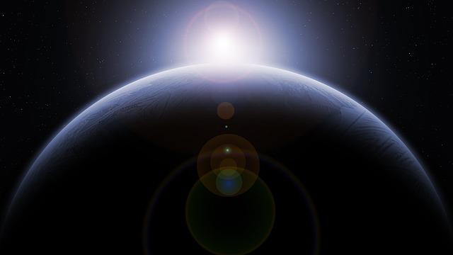 Imagem do planeta Terra visto do espaço, com o sol ao fundo
